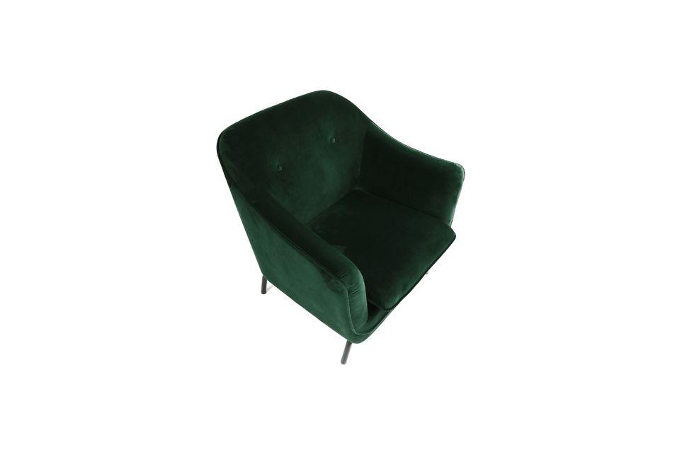 Grande poltrona in velluto verde scuro su gambe in metallo.