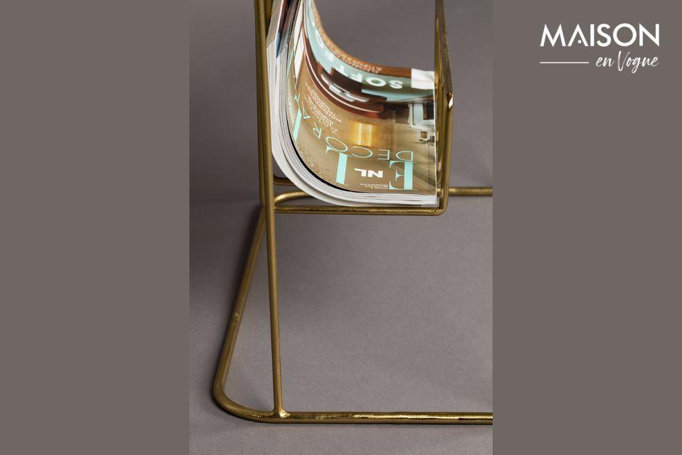La sua finissima struttura in metallo offre una tonalità dorata che richiama il piano del tavolo