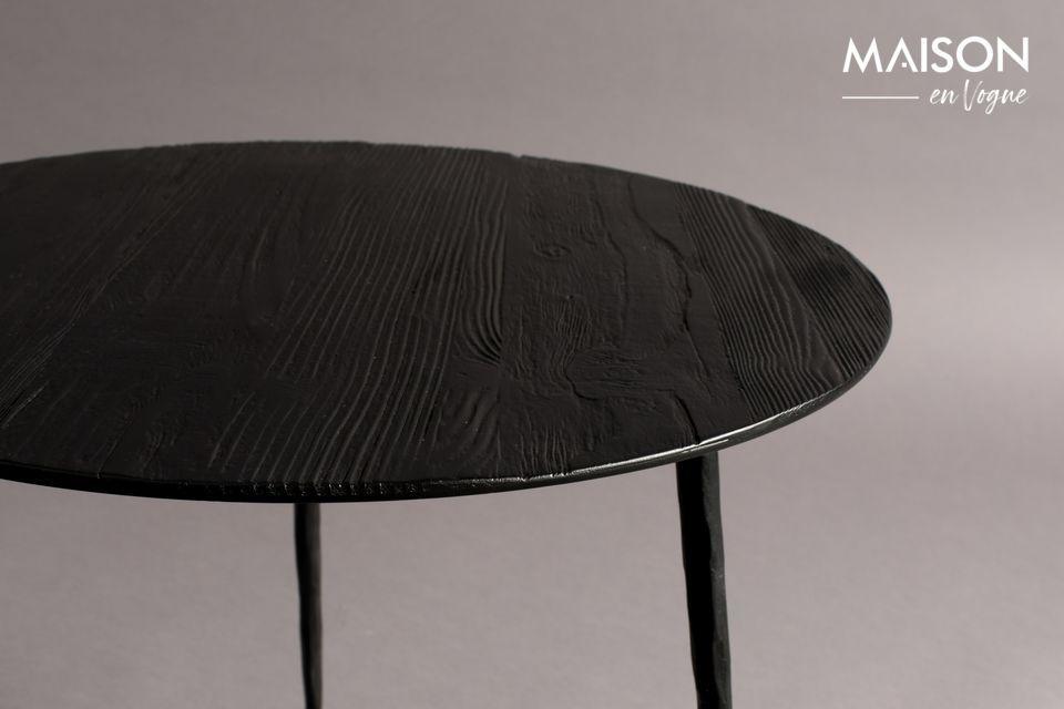 Il suo piano circolare in acciaio laccato ha un sottile impiallacciatura in pino o rovere